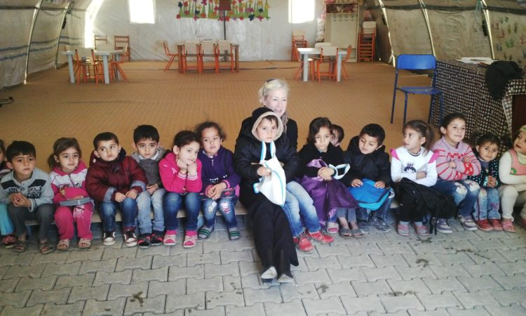Consul Linda Stuart Specht with Syrian refugee children in Midyat camp
